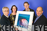 Colin Lacey Editor of Kerry's Eye presents Brid Halloran from Ballyvelly, Tralee Winner of the John Hurley Kerry's Eye Painting Competition with her prize also in photo are John Hurley Artist and Brendan Kennelly, Marketing Manager, Kerry's Eye.