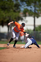 Baltimore Orioles Jeff Kemp (55) attempts to tag Engelb Vielma (7) sliding into second base during a minor league Spring Training game against the Minnesota Twins on March 16, 2016 at CenturyLink Sports Complex in Fort Myers, Florida.  (Mike Janes/Four Seam Images)