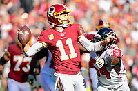 Landover, MD - November 4, 2018: Washington Redskins quarterback Alex Smith (11) is hit as he throws the football down field during game between the Atlanta Falcons and the Washington Redskins at FedEx Field in Landover, MD. The Falcons defeated the Redskins 38-13. (Photo by Phillip Peters/Media Images International)