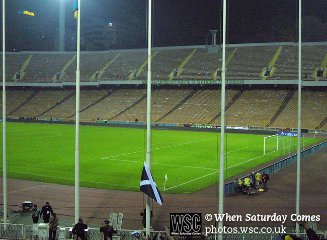 Ukraine 2 Scotland 2, 11/10/2006. Olympic Stadium, Euro 2008 Qualifying. A groundsman lowers the Scottish flag, the saltire, at the conclusion of the match between Scotland and Ukraine. Ukraine defeated Scotland 2-0 after a goal-less first half in this Euro 2008 group qualifying match played at the Olympic Stadium in Kyiv (Kiev). This was the first competitive international match between the countries. Photo by Colin McPherson.