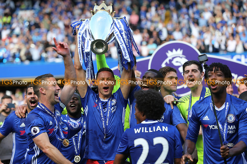 Chelsea's Nemanja Matic holds the Premier League Trophy aloft as he celebrates winning the Premier League during Chelsea vs Sunderland AFC, Premier League Football at Stamford Bridge on 21st May 2017