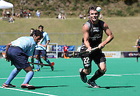 India's Arjun Halappa watches Lloyd Stephenson control the ball during the international hockey match between the New Zealand Black Sticks and India at National Hockey Stadium, Wellington, New Zealand on Saturday, 20 February 2009. Photo: Dave Lintott / lintottphoto.co.nz