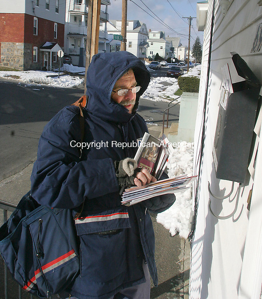 WATERBURY, CT.-11 DECEMBER 2009-121109DA05-Postal worker Mike Marrone delivers mail in a residential area in Waterbury Friday.<br /> <br />  Darlene Douty Republican-American