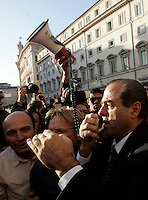 Il senatore e presidente dell'Italia dei Valori Antonio Di Pietro parla al megafono durante la protesta dei lavoratori di ex Eutelia ed Agile, aziende appartenenti al gruppo Omega davanti a Palazzo Chigi, Roma, 17 novembre 2009..Italian senator and former magistrate Antonio Di Pietro, president of L'Italia dei Valori party, speaks on a megaphone during a protest attended by Eutelia and Agile (Omega group) workers in front of Chigi Palace, Rome, 17 november 2009..UPDATE IMAGES PRESS/Riccardo De Luca