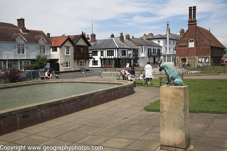 Famous statue of dog Snooks by the boating pond and The Moot Hall, Aldeburgh, Suffolk, England