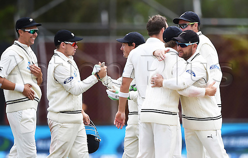 14.12.2015. Dunedin, New Zealand.  Players hug and celebrate as New Zealand win the test match on day 5 of the 1st cricket test match between New Zealand Black Caps and Sri Lanka at University Oval, Dunedin, New Zealand. Monday 14 December 2015.