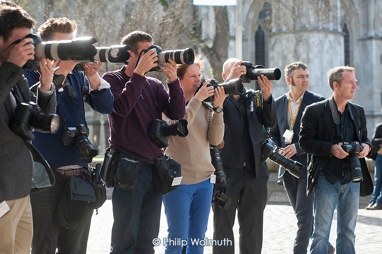 Photographers wait for the arrival of Nick Clegg and David Laws.  Liberal Democrat pre-election press conference, Westminster, London.