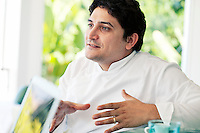 Mauro Colagreco, chef of restaurant Mirazur, talks at the bar, Menton, France, 18 September 2013