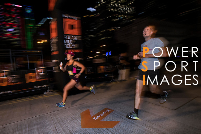 Runners compete at the Bloomberg Square Mile Relay on 9th November 2017 in Hong Kong's Central district, China. Photo by Marcio Rodrigo Machado / Power Sport Images