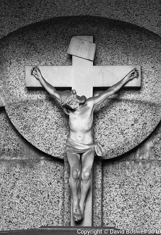 Christ on the cross decorates a crypt in the Cementario de la Recoleta in Buenos Aires, Argentina.