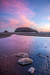 Harris Beach State Park, OR: Sunset on Harris Beach with Harris Creed reflectioning the sky colors and Goat Island in the distance,