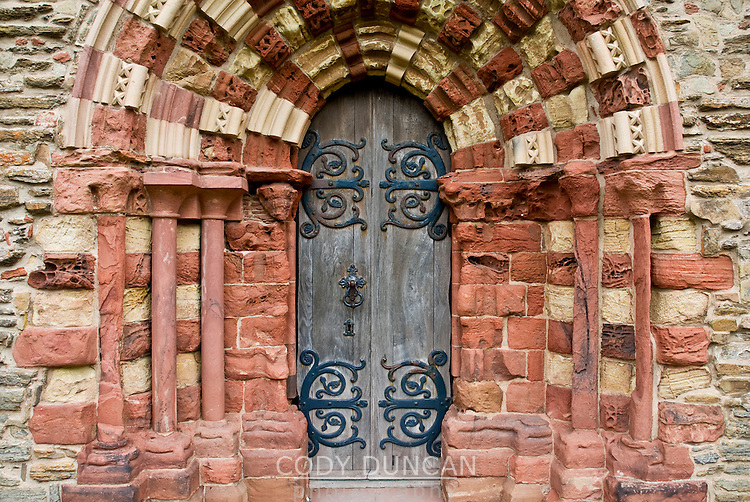 Door and worn sandstone of St. Magnus cathedral, Kirkwall, Orkney