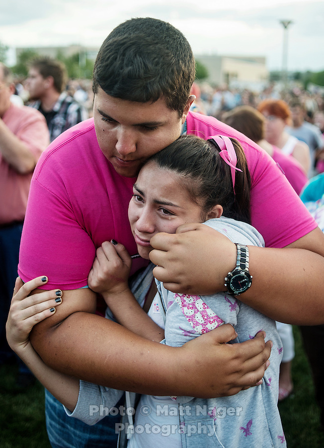 Travis Bahl, (cq, left), 20, and Rachel Trujillo (cq), 18, mourn Micayla Medek, 23, who was one of the 12 victims of the mass shooting at the Aurora Century 16 movie theater, during a prayer vigil at the Aurora Municipal Center, in Aurora, Colorado, Sunday, July 22, 2012. Suspect James Holmes, allegedly went on a shooting spree and killed 12 people and injured 59 during an early morning screening of 'The Dark Knight Rises.'..Photo by MATT NAGER
