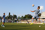 06 June 2015: Minnesota's Cristiano Dias (BRA) (right) heads the ball to Tiago Calvano (BRA) (left) during warmups. The Carolina RailHawks hosted Minnesota United FC at WakeMed Stadium in Cary, North Carolina in a North American Soccer League 2015 Spring Season match. The game ended in a 1-1 tie.