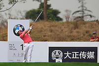 Kristoffer Broberg (SWE) tees off the 11th tee during Friday's Round 2 of the 2014 BMW Masters held at Lake Malaren, Shanghai, China 31st October 2014.<br /> Picture: Eoin Clarke www.golffile.ie