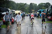 Alexander Kristoff (NOR/Katusha) getting to the race start through the pouring rain<br /> <br /> stage 21: Sèvres - Champs Elysées (109km)<br /> 2015 Tour de France