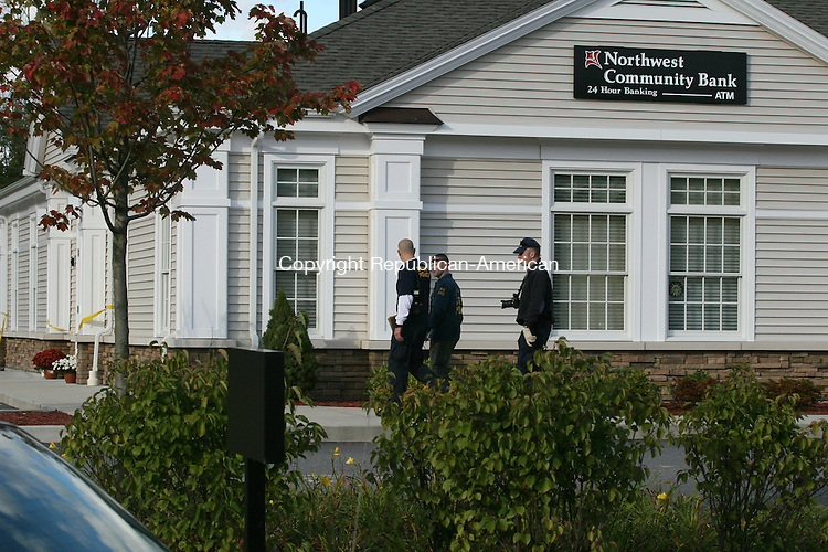 NEW HARTFORD, CT - 10 October, 2009 - 101009MO01 - State Police Major Crime Squad Detectives spent most of the day investigating a Saturday morning robbery of the Northwest Community Bank branch in New Hartford. Jim Moore Republican-American.