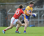 Eoin Cleary of Clare in action against Brian O Driscoll of Cork during their National Football League game at Cusack Park. Photograph by John Kelly.