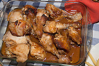 Glass baking dish filled with baked chicken covered with gravy a wonderful Polish meal. Zawady Central Poland
