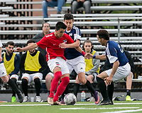 Malden, Massachusetts - May 27, 2017:  In a National Premier Soccer League (NPSL) match, Boston City FC (red/white) defeated Seacoast United Mariners (blue/white), 6-1, at Brother Gilbert Stadium on Donovan Field.