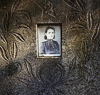 Portrait of a woman on a gravestone in a Soviet army cemetery. . CHECK with MRM/FNA