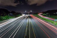 A long-exposure image of traffic on the H-1 Freeway at night in 'Aiea, O'ahu.