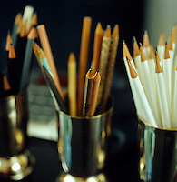 Andree Putman's collection of pencils are stored in a series of small metal vases on top of her desk
