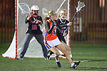 Santa Barbara, CA 02/18/12 - Brittini Peck (Florida #15) and unidentified Chapman player(s) in action during the Chapman - Florida matchup at the 2012 Santa Barbara Shootout.  Florida defeated Chapman 12-11.