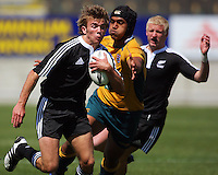 Ale Kotoni tries to tackle the flying Rhys Llewellyn during the International rugby match between New Zealand Secondary Schools and Suncorp Australia Secondary Schools at Yarrows Stadium, New Plymouth, New Zealand on Friday, 10 October 2008. Photo: Dave Lintott / lintottphoto.co.nz