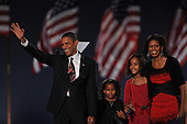 Chicago, IL - November 4, 2008 -- United States President-elect Barak Obama speaks in Lower Hutchinson Field, Grant Park, Chicago, Illinois after his election as President of the United States on Tuesday, November 4, 2008.  From left to right: President-elect Obama, Sasha Obama, Malia Obama, Michelle Obama..Credit: Ron Sachs / CNP.(Restriction: No New York Metro or other Newspapers within a 75 mile radius of New York City)