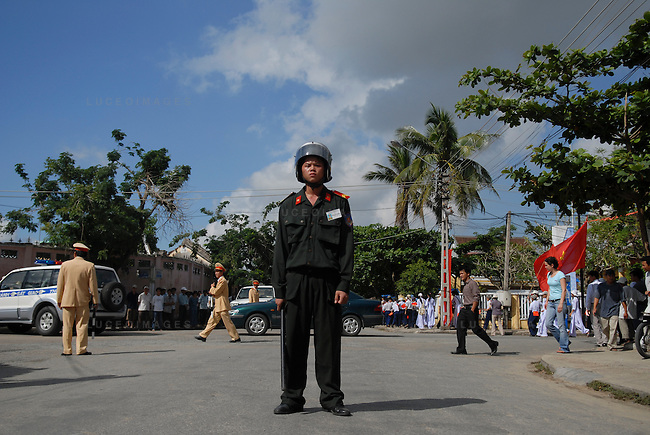 A Vietnamese police officer directs traffic in Hoi An, Vietnam.