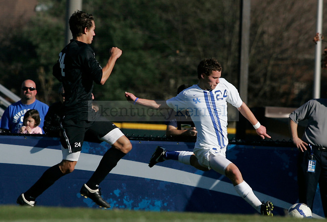 UK's freshman forward Jacob Kemper kicks the ball across the field during the men's soccer game against High Point University at the Soccer and Softball Complex on Sunday afternoon, Nov. 8, 2009. The Wildcats won 2-0 to the Panthers. Photo by Adam Wolffbrandt | Staff
