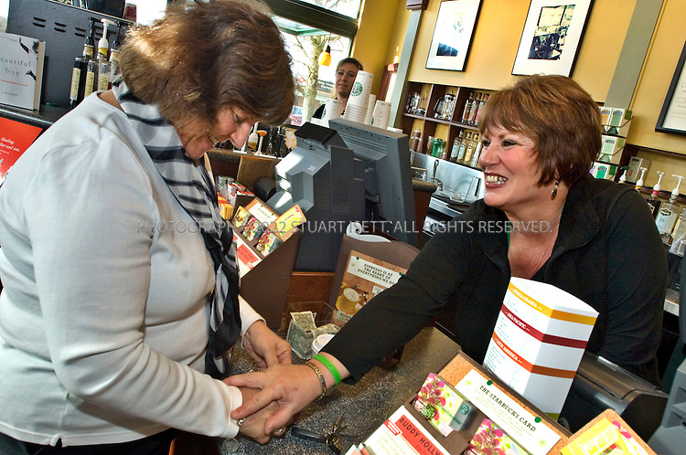 2/28/2008--Tacoma, WWA, USA..Annamarie Ausnes (left) orders her usual small drip coffee from Sandie Andersen (right) who works at Ausnes's favorite Starbucks in Tacoma WASH. ..On March 11, Ms. Andersen and Ms. Ausnes are scheduled to go into surgery at Virginia Mason Medical Center in Seattle. If all goes well, when they come out Ms. Ausnes, 55, who suffers from polycystic kidney disease and was set to go on dialysis this spring, will be the new owner of Ms. Anderson?s left kidney. Ms. Anderson, 51, has worked at Starbucks for more than four years. ..©2008 Stuart Isett. All rights reserved.
