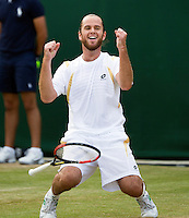 29-06-12, England, London, Tennis , Wimbledon, Xavier Malisse  defeats Fernabdo Verdasco and goes on his knees