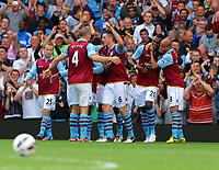 Saturday 15 September 2012<br /> Pictured: Aston Villa goalscorer Christian Benteke (2nd R) is hugged by team mate Karim El Ahmadi (R) and celebrating with other team mates.<br /> Re: Barclay's Premier League, Aston Villa v Swansea City FC at Villa Park, West Midlands, UK.
