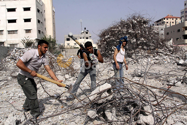 Palestinian workers extract iron from the rubbles of the  Ministry of Justice which destroyed during the last year Israeli offensive on Gaza Strip, in Gaza City on Feb 20,2010. Photo by Mohammed Asad