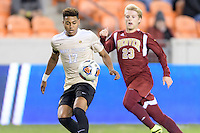 Houston, TX - Friday December 9, 2016: Logan Gdula (17) of the Wake Forest Demon Deacons gains control of a loose ball against the Denver Pioneers at the NCAA Men's Soccer Semifinals at BBVA Compass Stadium in Houston Texas.