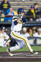 Michigan Wolverines third baseman Jake Bivens (18) follows through on his swing against the Central Michigan Chippewas on March 29, 2016 at Ray Fisher Stadium in Ann Arbor, Michigan. Michigan defeated Central Michigan 9-7. (Andrew Woolley/Four Seam Images)