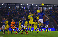 AFC Wimbledon's Tom Soares heads the ball despite the attentions of Oldham Athletic's Craig Davies during the Sky Bet League 1 match between Oldham Athletic and AFC Wimbledon at Boundary Park, Oldham, England on 21 November 2017. Photo by Juel Miah/PRiME Media Images