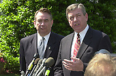 "United States Secretary of Health and Human Services Tommy Thompson, left, and Attorney General John Ashcroft, right, meet reporters at the White House following the Rose Garden event where U.S. President George W. Bush named John P. Walters  to be the ""Drug Czar"" in the Rose Garden of the White House in Washington, D.C. on May 10, 2001..Credit: Ron Sachs / CNP"