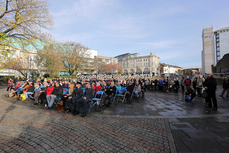 Pictured: Hundreds of people attend the service Friday 11 November 2016<br />Re: Remembrance Day service at Castle Square Gardens in Swansea, south Wales, UK.