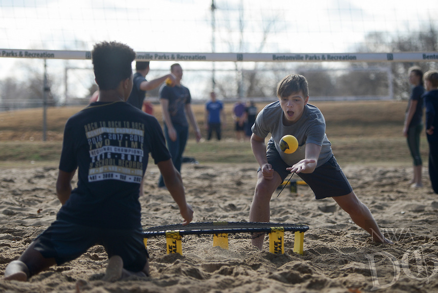 NWA Democrat-Gazette/CHARLIE KAIJO Josh Bruce, 16, of Centerton and Giovanni Alawdi, 15, of Bentonville (from right) play spike ball during a spike ball tournament, Monday, January 7, 2019 at Memorial Park in Bentonville. <br />