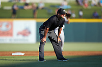 Third base umpire Charlie Ramos works the International League game between the Scranton/Wilkes-Barre RailRiders and the Gwinnett Stripers at BB&T BallPark on August 17, 2019 in Lawrenceville, Georgia. The Stripers defeated the RailRiders 8-7 in eleven innings. (Brian Westerholt/Four Seam Images)