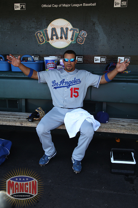 SAN FRANCISCO - JUNE 30:  Rafael Furcal #15 of the Los Angeles Dodgers gets ready in the dugout before the game against the San Francisco Giants at AT&T Park on June 30, 2010 in San Francisco, California. Photo by Brad Mangin