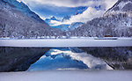 Ice and reflection on lake by Aleš Krivec