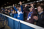 Peterborough United 1 Chesterfield 0, 21/03/2015. Abax Stadium, League One. Home supporters in the London Road stand covered terrace cheering at the final whistle at the Abax Stadium, as Peterborough United play Chesterfield in a SkyBet League One fixture. The home team won the match by one goal to nil, watched by a crowd of 6,612. The result allowed Peterborough to leapfrog their opponents into the League One play-off positions with eight games remaining of the season. Photo by Colin McPherson.