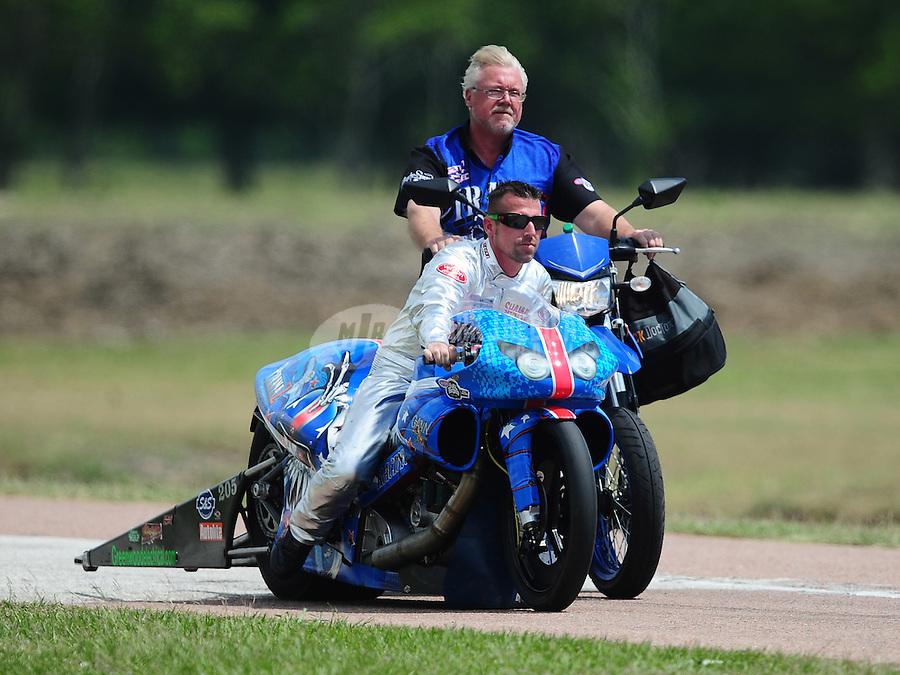 Apr. 28, 2012; Baytown, TX, USA: NHRA pro stock motorcycle rider Shawn Gann during qualifying for the Spring Nationals at Royal Purple Raceway. Mandatory Credit: Mark J. Rebilas-