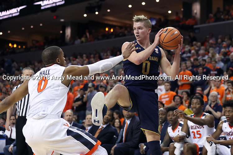 CHARLOTTESVILLE, VA - MARCH 03: Notre Dame's Rex Pflueger (right) and Virginia's Devon Hall (left). The University of Virginia Cavaliers hosted the University of Notre Dame Fighting Irish on March 3, 2018 at John Paul Jones Arena in Charlottesville, VA in a Division I men's college basketball game. Virginia won the game 62-57.