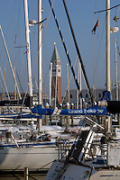The campanile of St Marks square through the masts of the yachts on the the island of San Giorgio Maggiore. Venice, Italy. May 2007