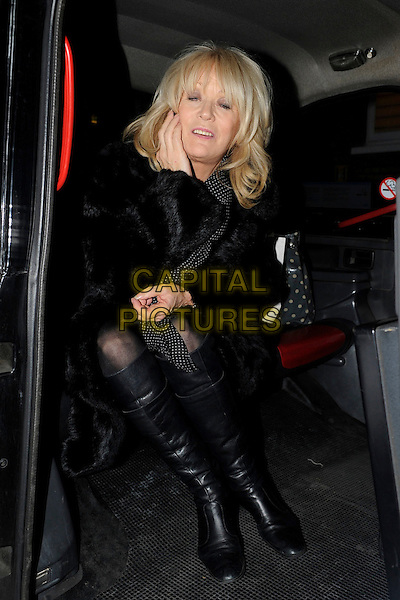 Sherrie Hewson.Spotted in London, England..13th January 2012.full length black fur coat boots car cab taxi sitting talking on mobile phone eyes closed blink blinking .CAP/IA.©Ian Allis/Capital Pictures.